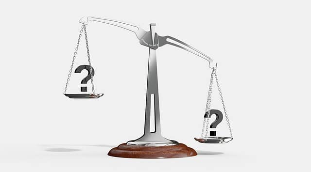 Legal scales with question marks