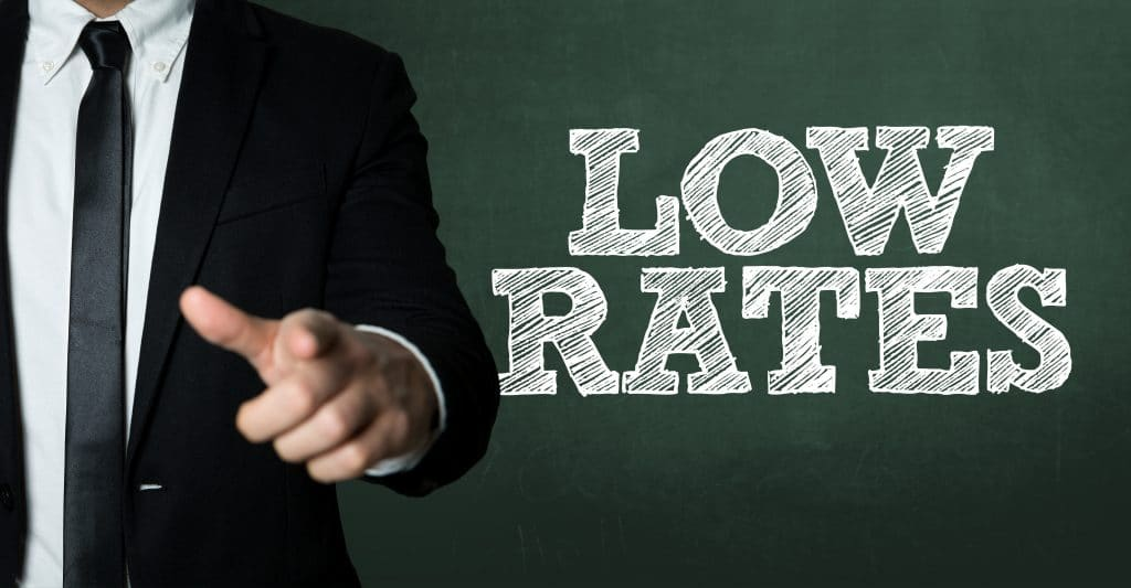 Business man pointing with the text: Low Rates
