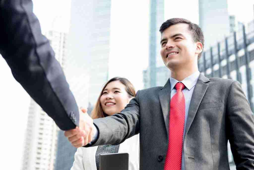 Businessman making handshake after closing deal