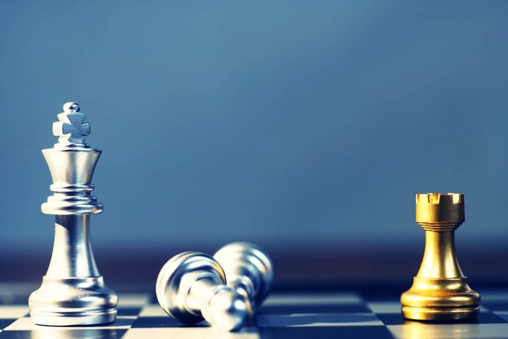 chess pieces showing disadvantage