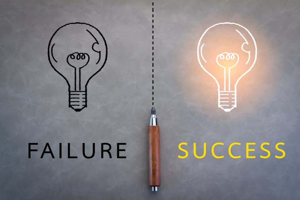 failure or success business concept pencil on grey background