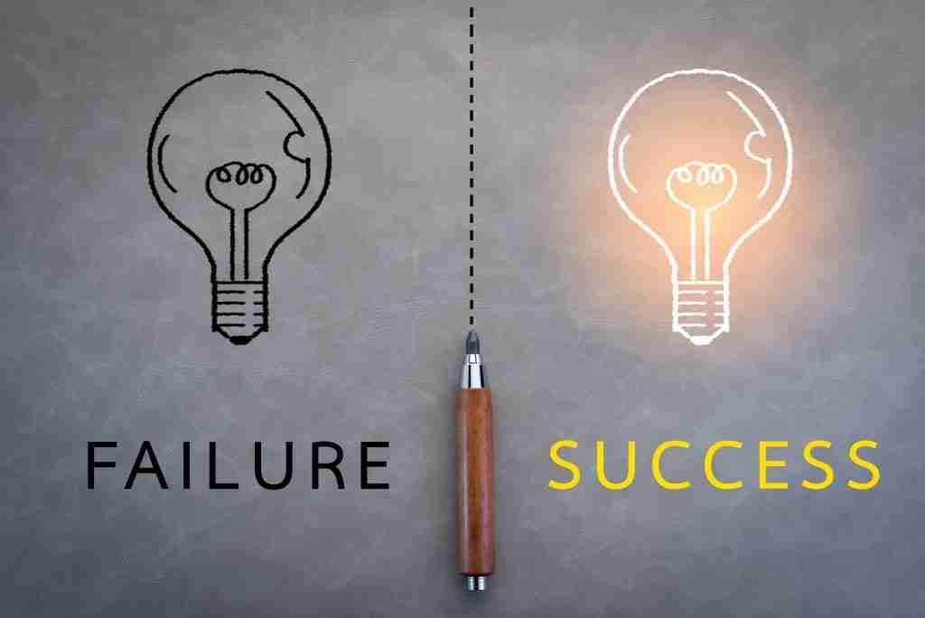 Lightbulbs with failure & success in writing underneath