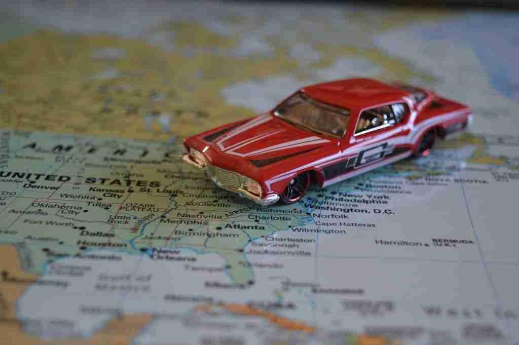 Little matchbox car on a paper roadmap