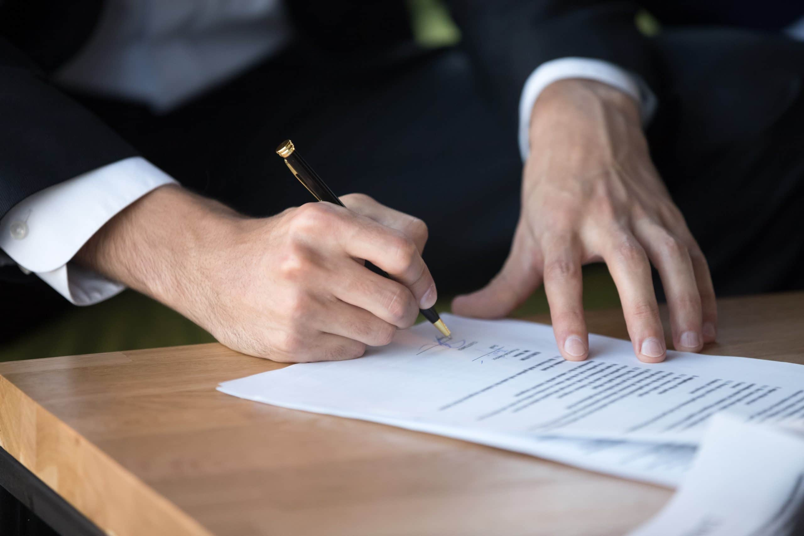 Real estate Investor signing papers