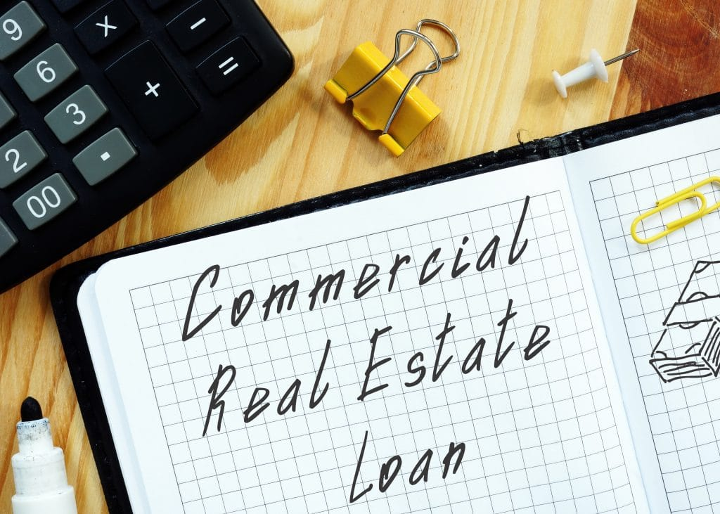 commercial real estate loan written on a pad of paper