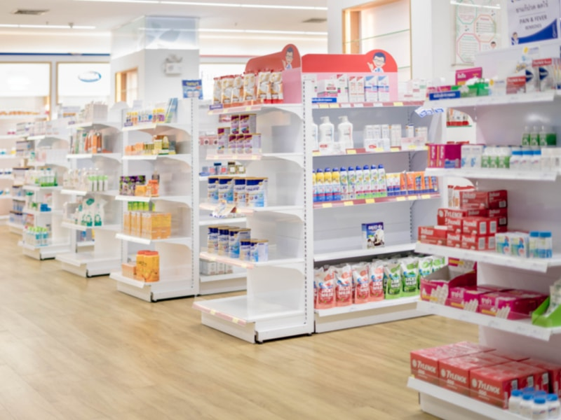 Shelves full of products in a pharmacy store