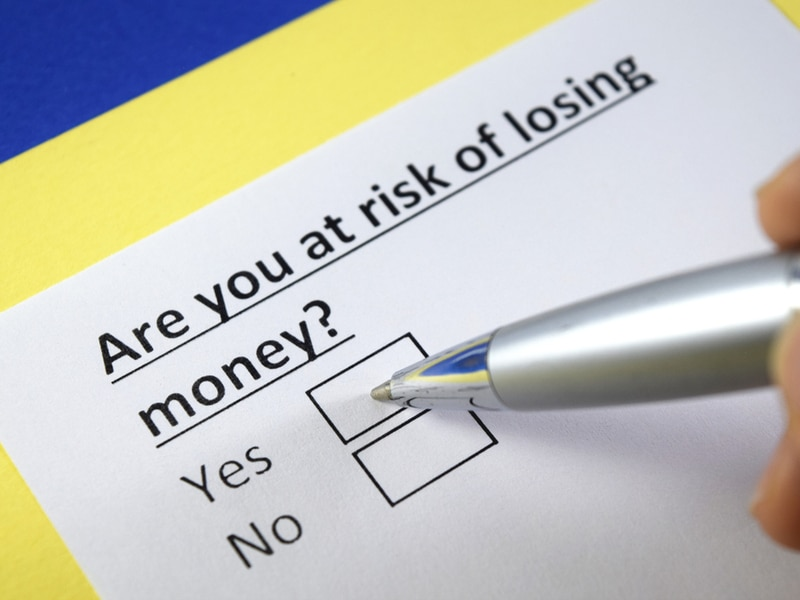 """check box on paper """"are you at risk of losing money?"""" yes or no"""