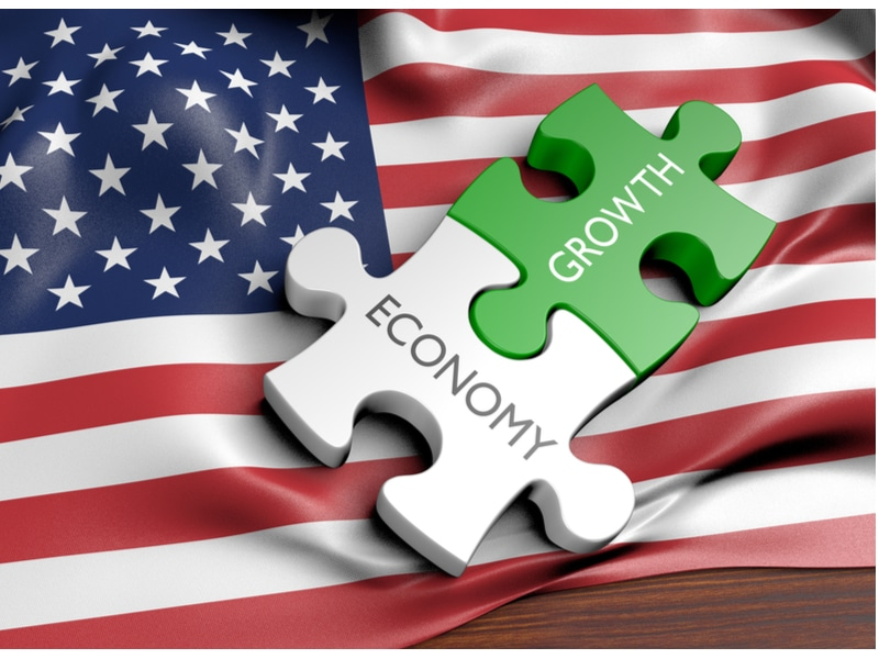 """American Flag with puzzle pieces that say """"economy"""" and """"growth"""""""