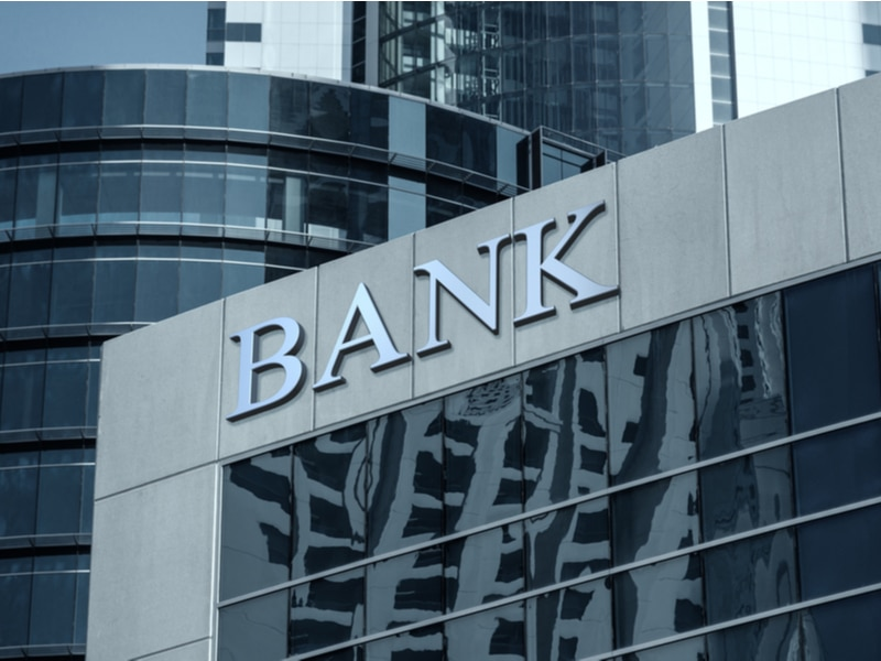 Bank in a section of a city with glass buildings around it