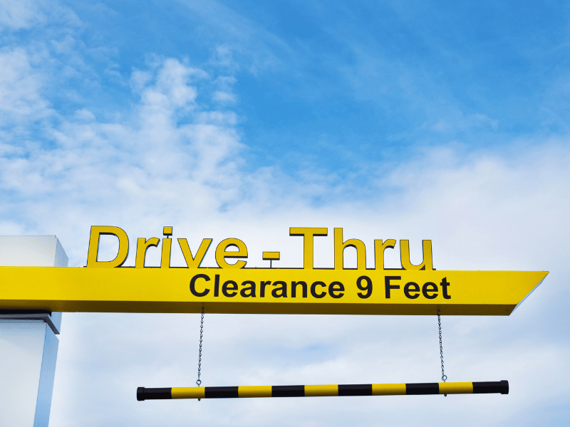 Drive-Thru sign with daytime sky