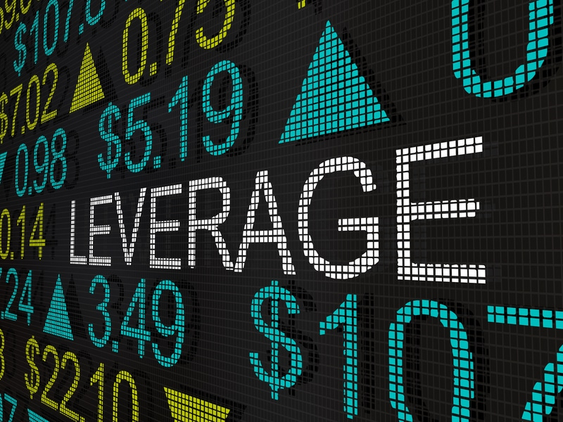 The words leverage on a stock ticker board