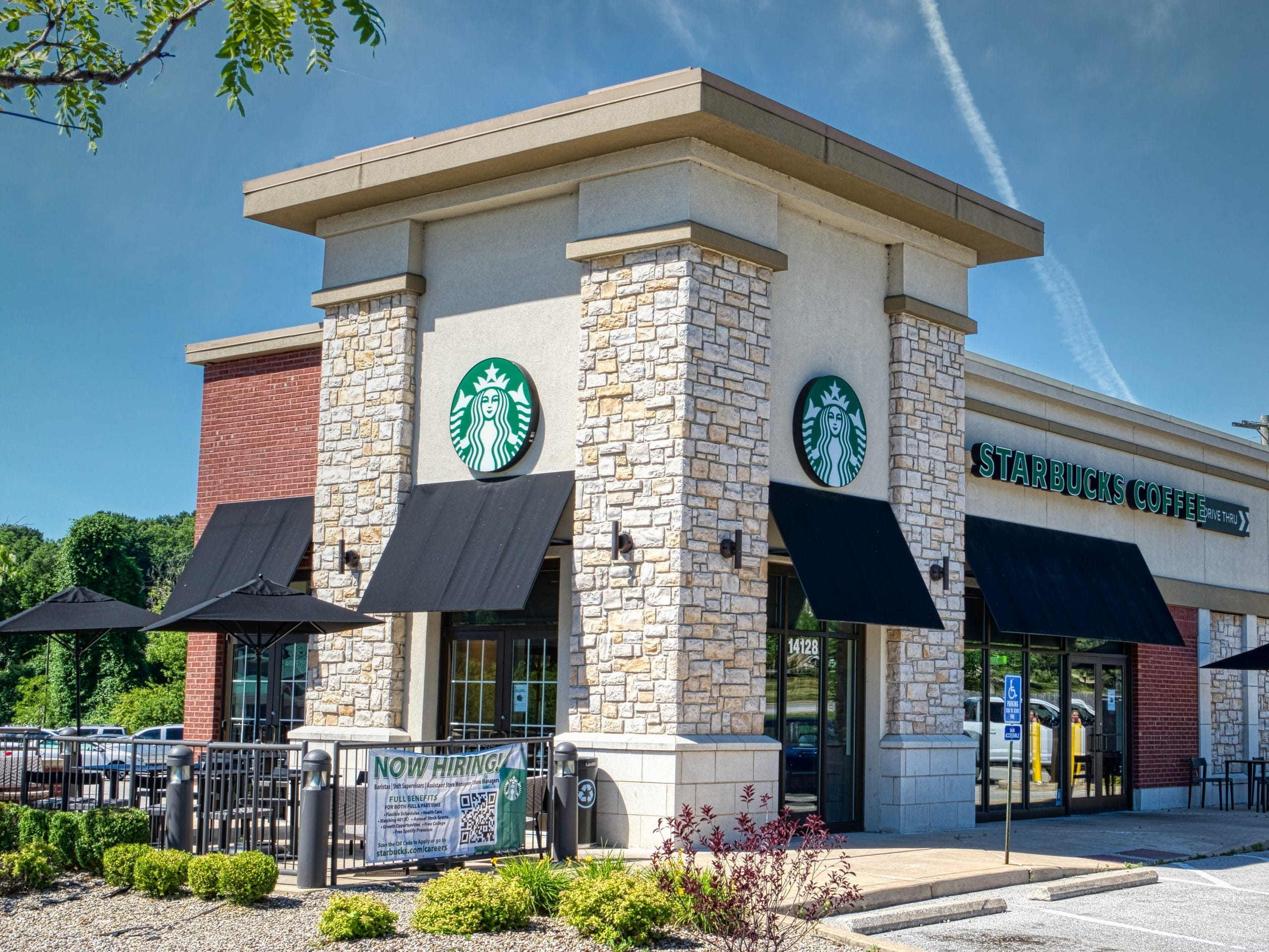 Starbucks cafe, outside view, patio with tables and umbrellas