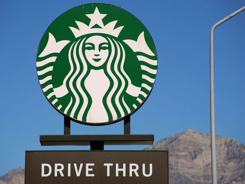 Starbucks Drive thru sign with mountains in the background